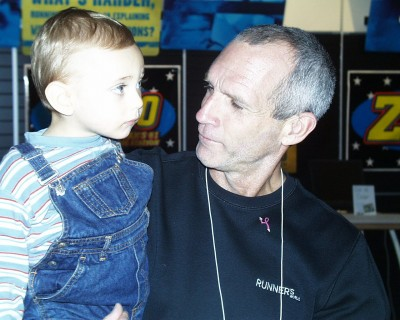 My son Evan being held by Bart Yasso of Runner's World